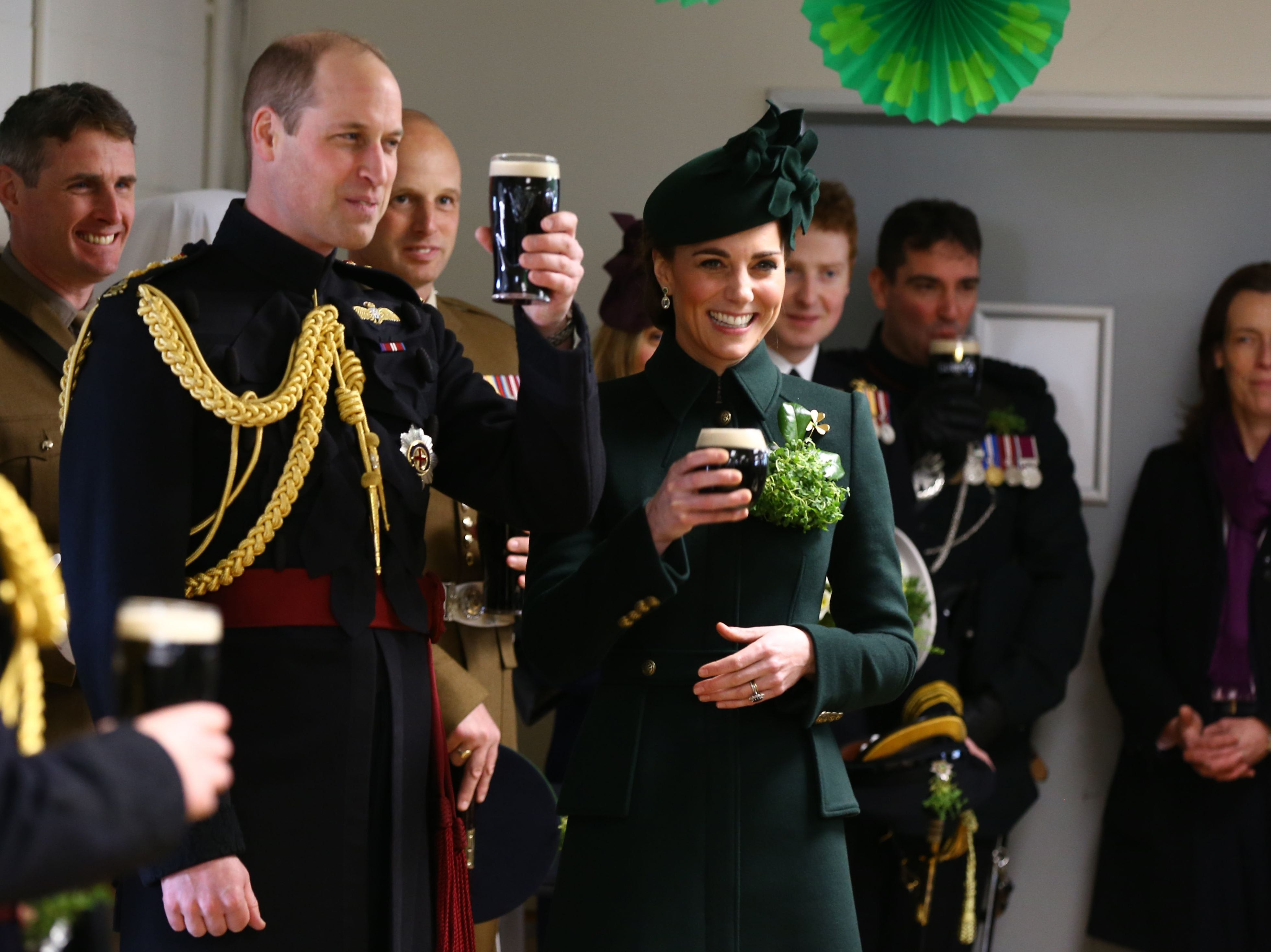 Britain's Prince William, Duke of Cambridge and Britain's Catherine, Duchess of Cambridge enjoy a pint of Guinness with officers and guardsmen of the 1st Battalion Irish Guards after the St Patrick's Day parade, at Cavalry Barracks in Hounslow, west London, on March 17, 2019.