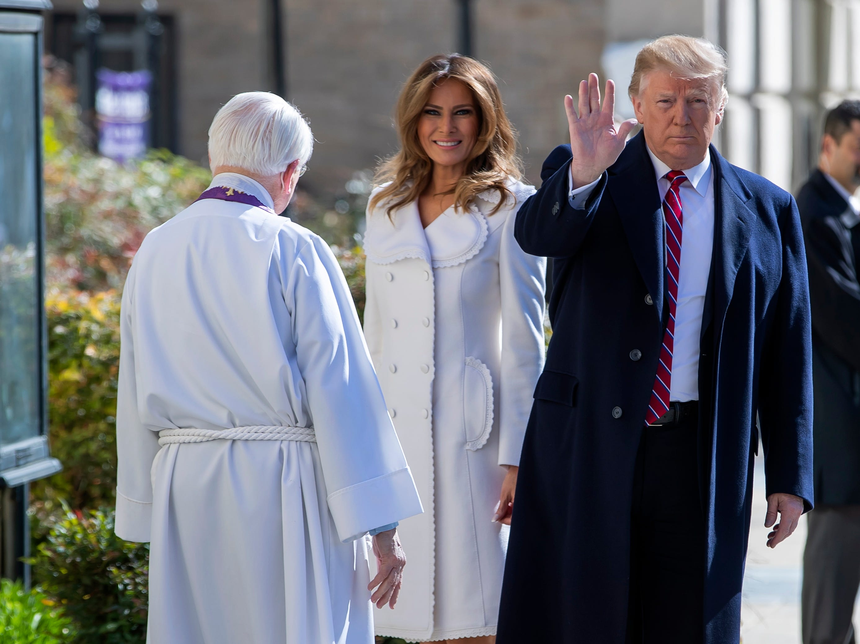 President Donald J. Trump and First Lady Melania Trump are greeted by Reverend W. Bruce McPherson as they attend services at St. John's Episcopal Church in Washington, DC on St. Patrick's Day.