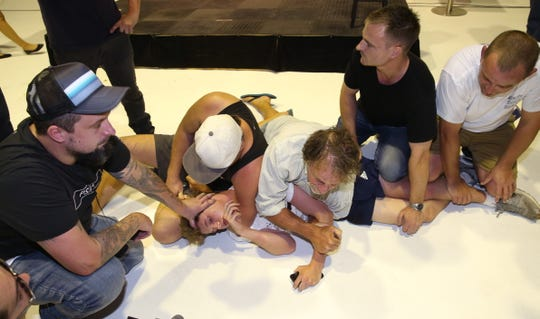 Supporters hold down a left-wing activist after he smashed an egg over the head of Senator Fraser Anning of the Conservative National Party after he addressed a political meeting in Moorabbin, Melbourne, Australia, 16 March 2019. The Senator has been widely criticized for posting a statement in regards to the New Zealand mosque attacks.