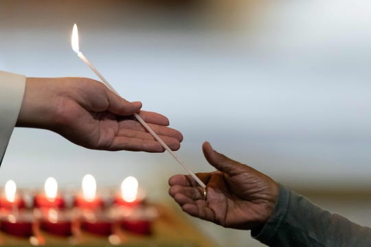 Australian politicians and religious leaders light candles at an interfaith service at St Marys Cathedral in Sydney on March 17, 2019.