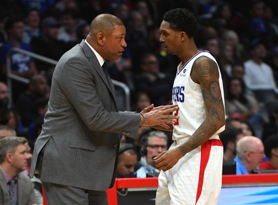 Doc Rivers talks with Lou Williams, who has won the NBA's Sixth Man of the Year honor twice.