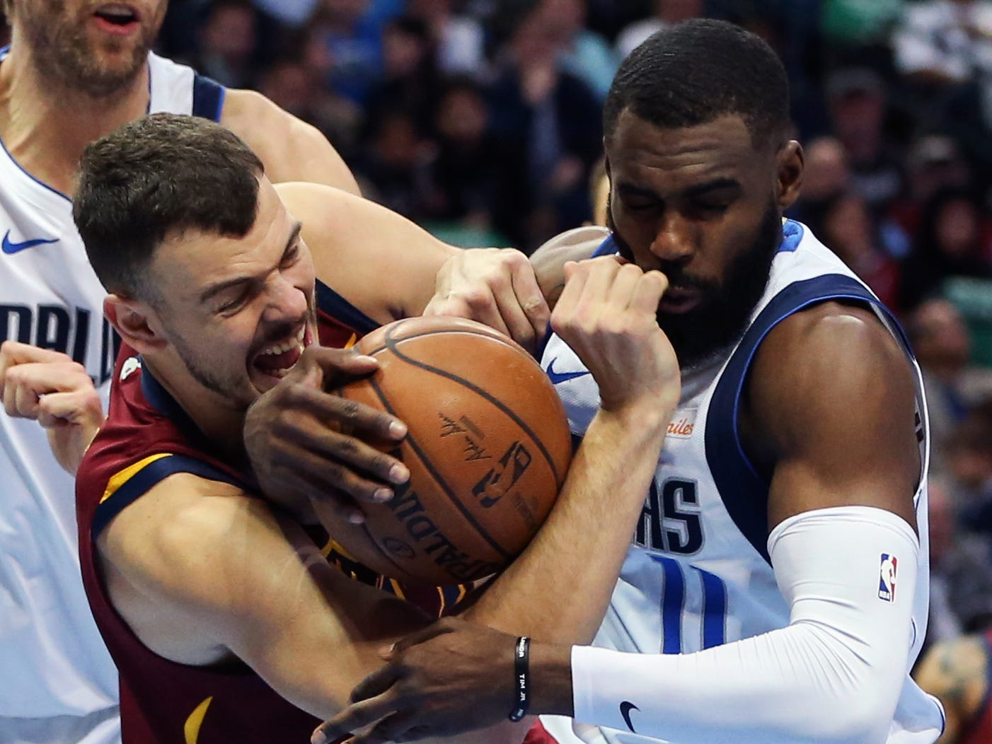 March 16: Mavericks guard Tim Hardaway Jr. (11) fights for a rebound with Cavaliers center Ante Zizic (41) during the first half in Dallas.