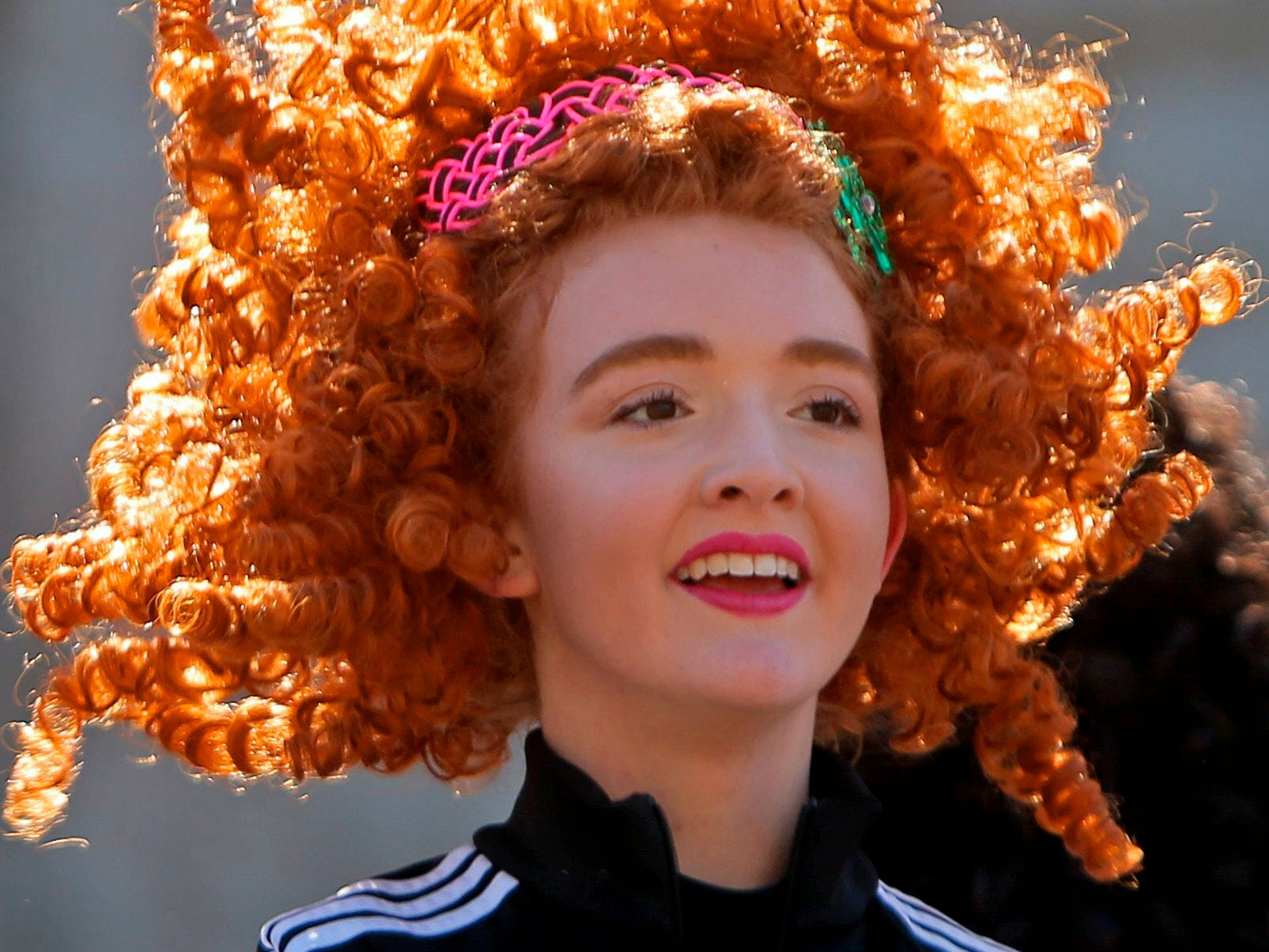 Anika Wagner, a dancer with the Clark Academy School of Dance, performs on a float with her group in the 50th Annual St. Patrick's Day Parade, Saturday, March 16, 2019, in downtown St. Louis.