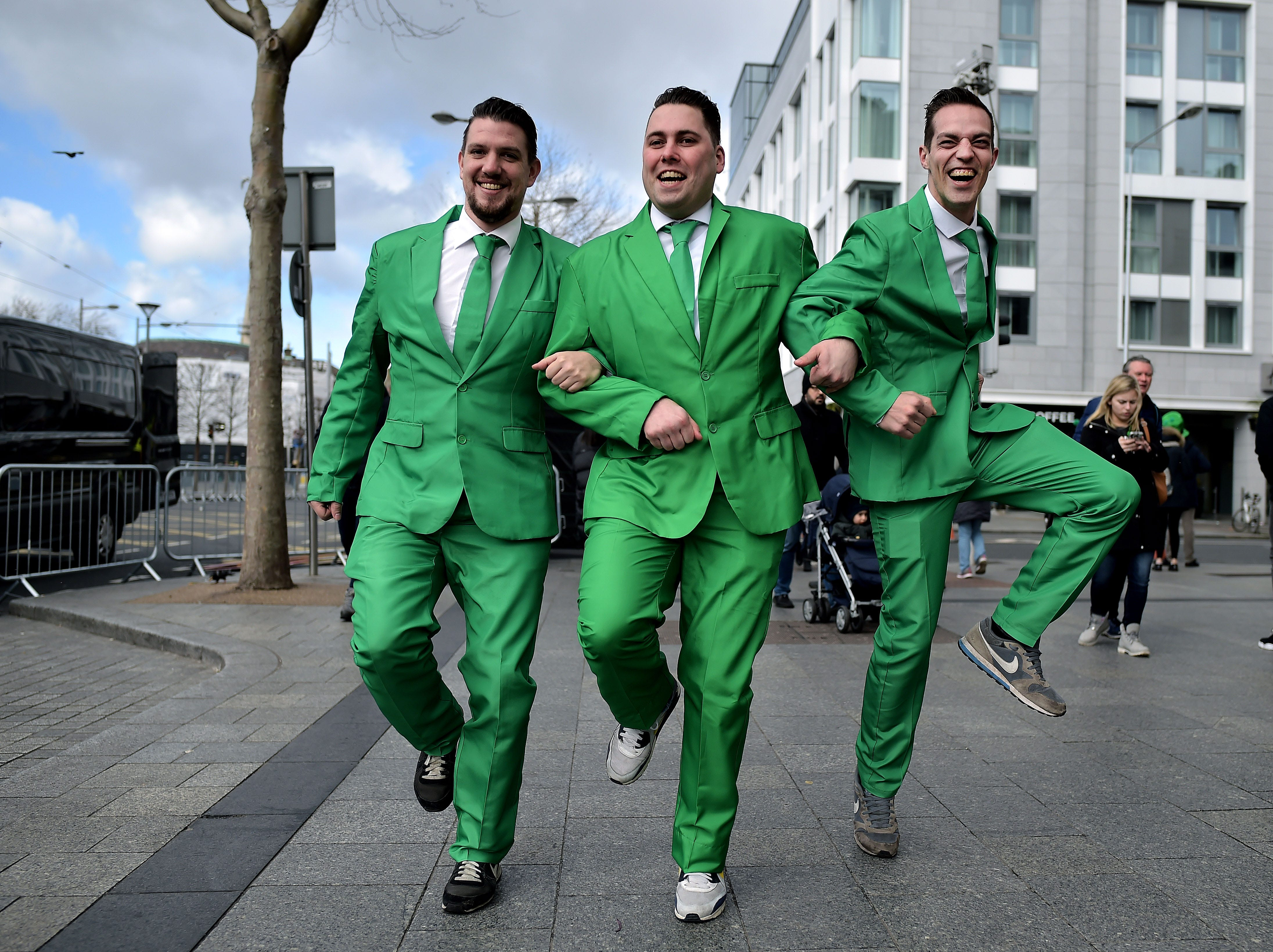 Revelers attend the Saint Patrick's Day parade on March 17, 2019 in Dublin, Ireland. Saint Patrick, the patron saint of Ireland is celebrated around the world on St. Patrick's Day. According to legend Saint Patrick used the three-leaved shamrock to explain the Holy Trinity to Irish pagans in the 5th-century after becoming a Christian missionary.