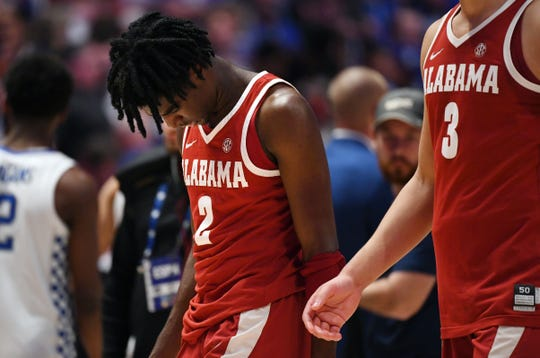 Alabama Crimson Tide guard Kira Lewis Jr. (2) reacts as he walks off the floor after a loss against the Kentucky Wildcats in the SEC conference tournament.