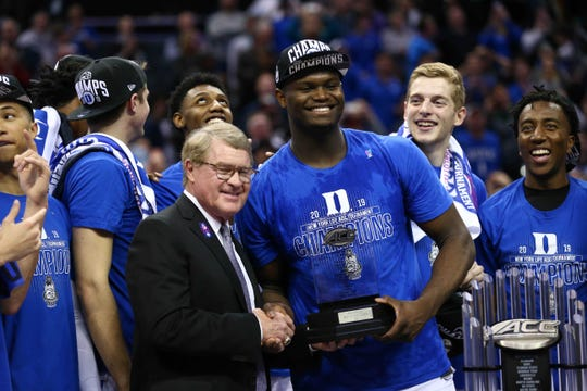 ACC Commissioner John Swofford presents Duke forward Zion Williamson  with the tournament MVP trophy in the conference tournament.