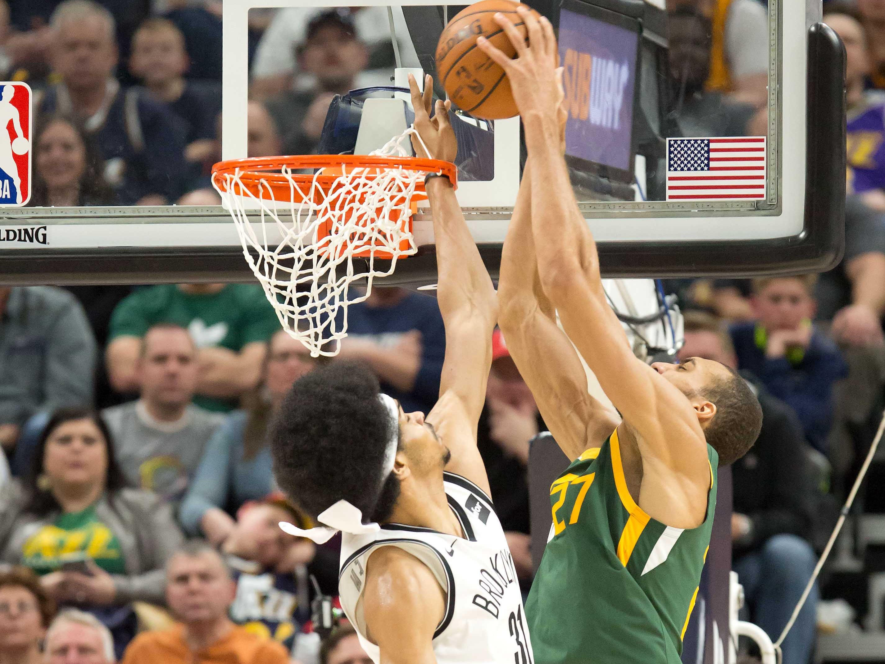 March 16: Jazz center Rudy Gobert (27) throws down the two-handed slam over Nets defender Jarrett Allen (31) during the second half in Salt Lake City.