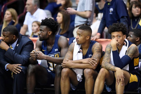 UNC-Greensboro bench reacts as their team loses the lead against Wofford in the second half the team's Southern Conference tournament championship loss.