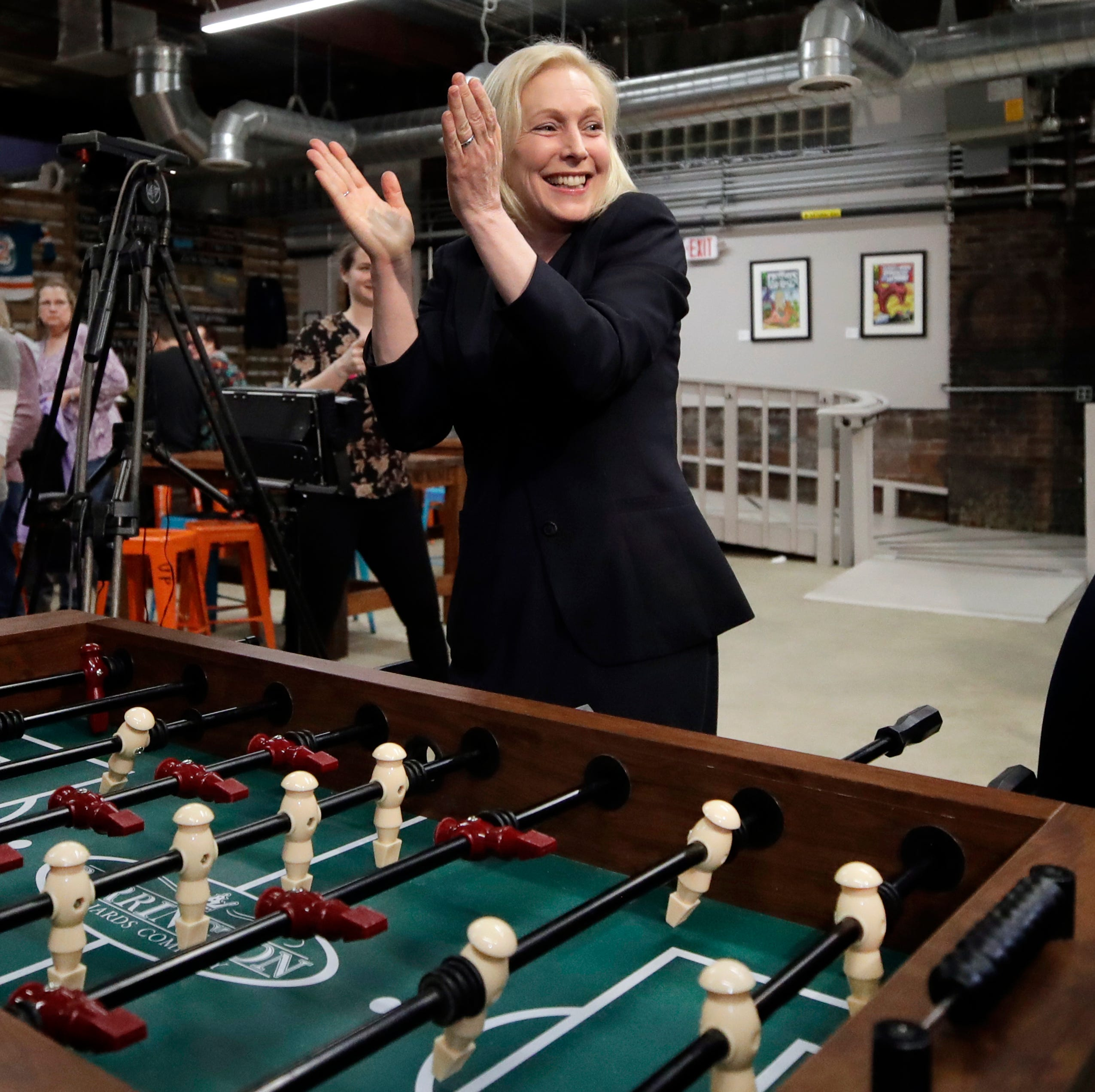 Democratic presidential candidate Sen. Kirsten Gillibrand, D-N.Y., celebrates her foosball victory at a campaign meet-and-greet, Friday, March 15, 2019, at To Share Brewing in Manchester, N.H.