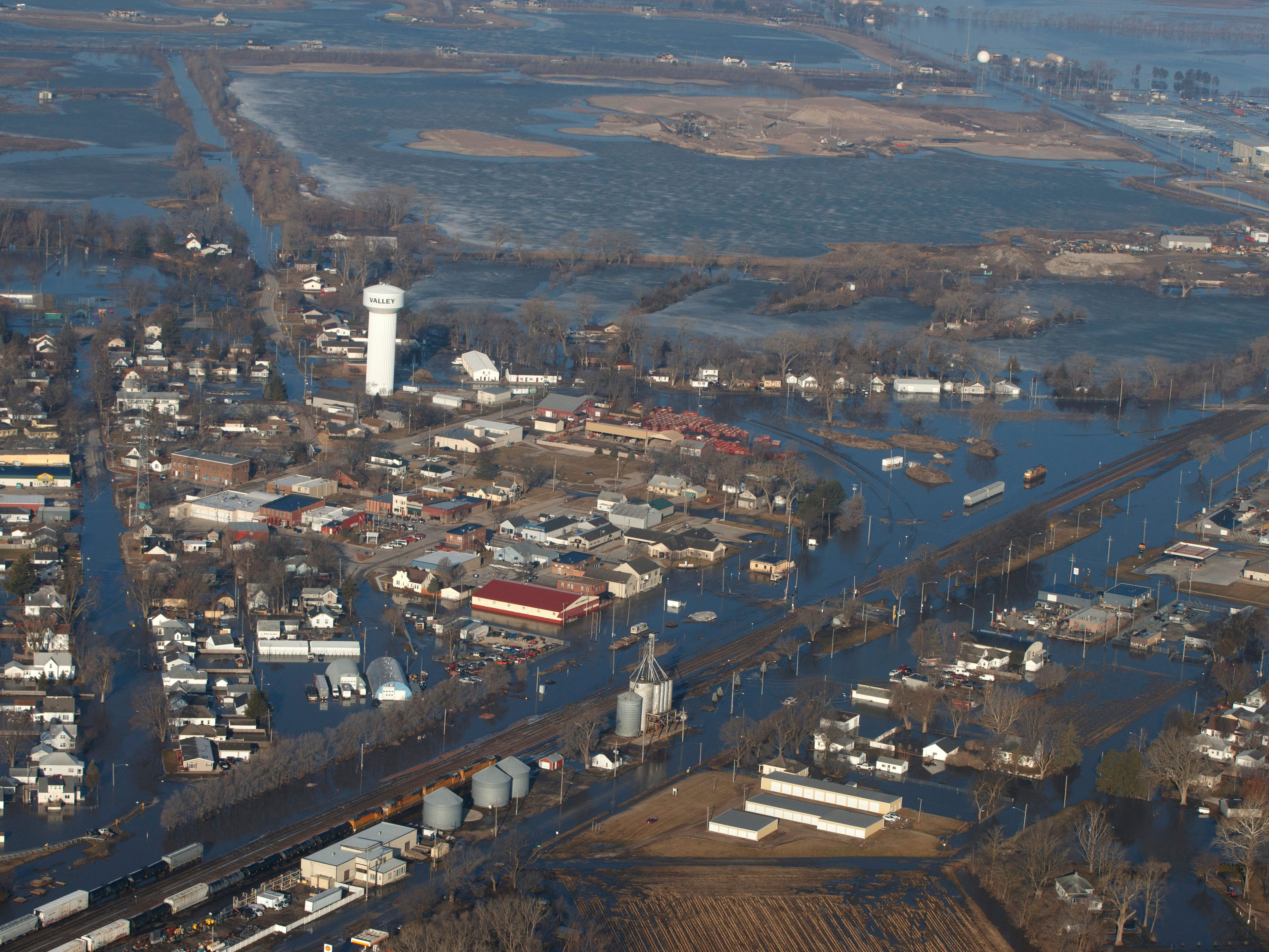 The city of Valley is inundated with floodwaters Sunday, March 17, 2019, in Valley, Neb.