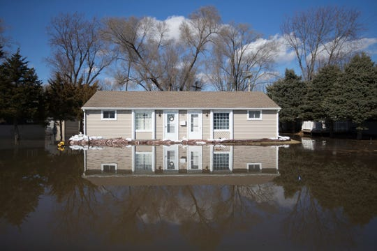 The Rock River crested its banks and floods a home on Old Harlem Road on March 16, 2019, in Machesney Park, Ill.