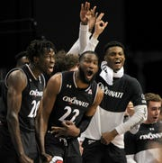 The Cincinnati Bearcats bench reacts during the second half against the Houston Cougars in the AAC title game.