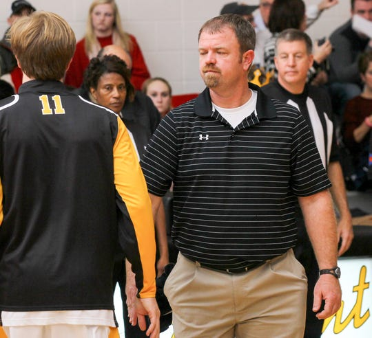 Crescent's Dalston Davis, left, is introduced near coach Cade Gray before the Powdersville game in Iva in 2013.