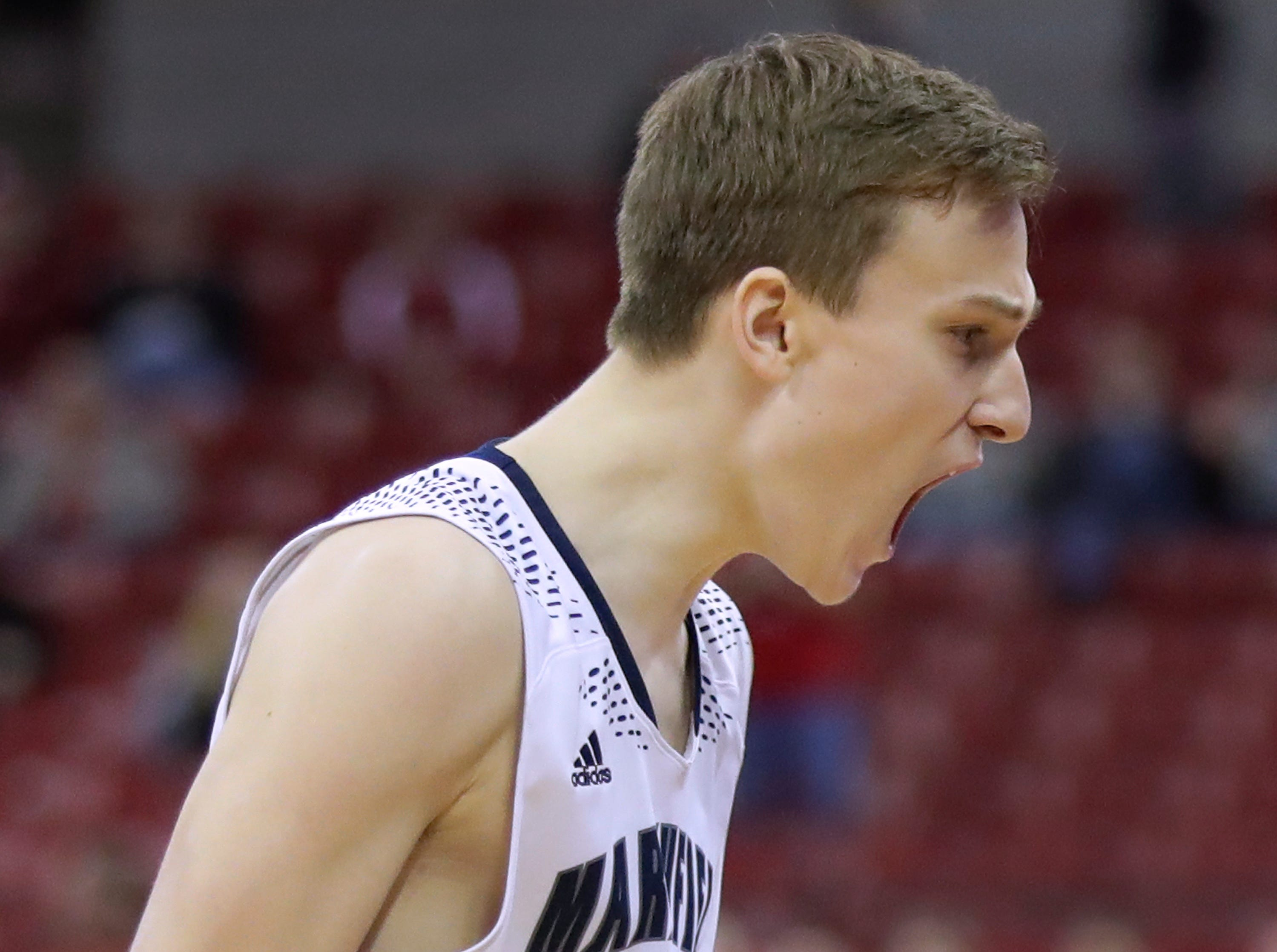 Columbus Catholic High School's #21 Tom Nystrom reacts after shooting a game winning three-pointeer in the closing seconds against Bangor High School during their WIAA Division 5 boys basketball state semifinal on Friday, March 15, 2019, at the Kohl Center in Madison, Wis. Clumbus defeated Bangor 69 to 66.Wm. Glasheen/USA TODAY NETWORK-Wisconsin.