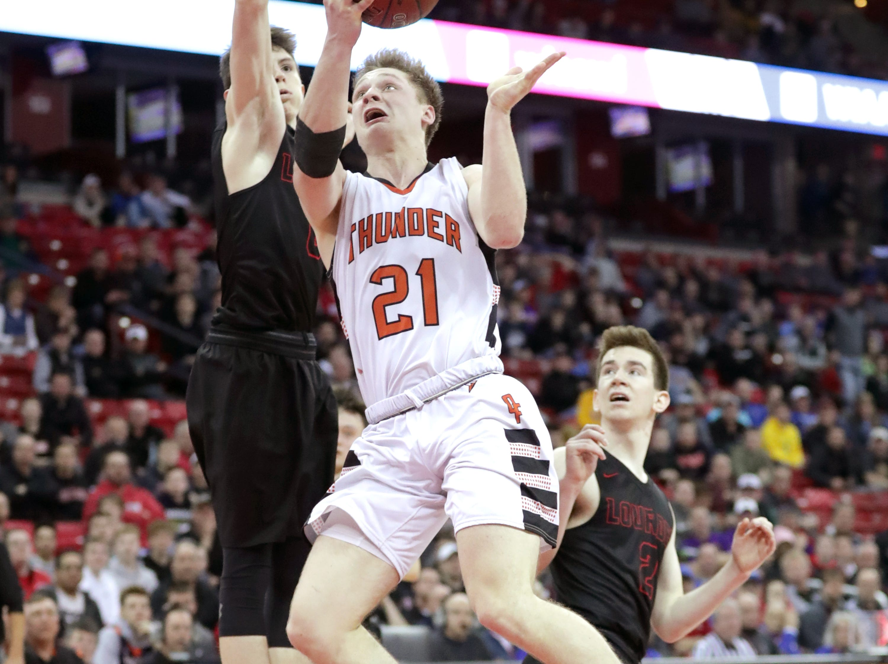 Lourdes Academy's and #0 Hayden Jones against Osseo-Fairchild High School's #21 Logabn Mulhern during their WIAA Division 4 boys basketball state semifinal on Thursday, March 14, 2019, at the Kohl Center in Madison, Wis. Lourdes defeated Osseo-Fairchild 70 to 68.Wm. Glasheen/USA TODAY NETWORK-Wisconsin.