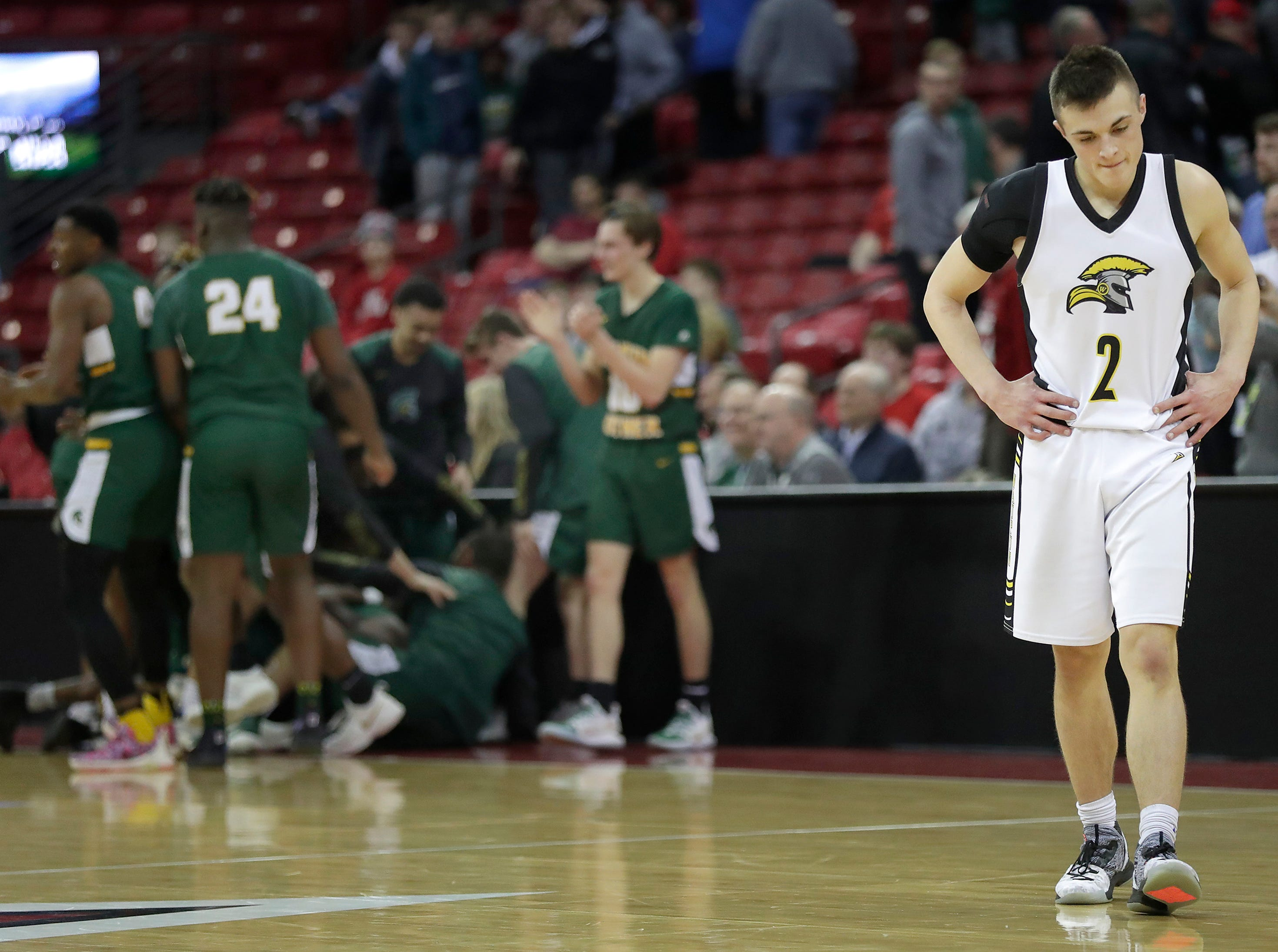 Waupun High School's #2 Trevor VandeZande leaves the court after his team's loss to Martin Luther High School in the WIAA Division 3 boys basketball state championship game on Saturday, March 15, 2019, at the Kohl Center in Madison, Wis. Martin Luther defeated Waupun 58 to 49.Wm. Glasheen/USA TODAY NETWORK-Wisconsin.