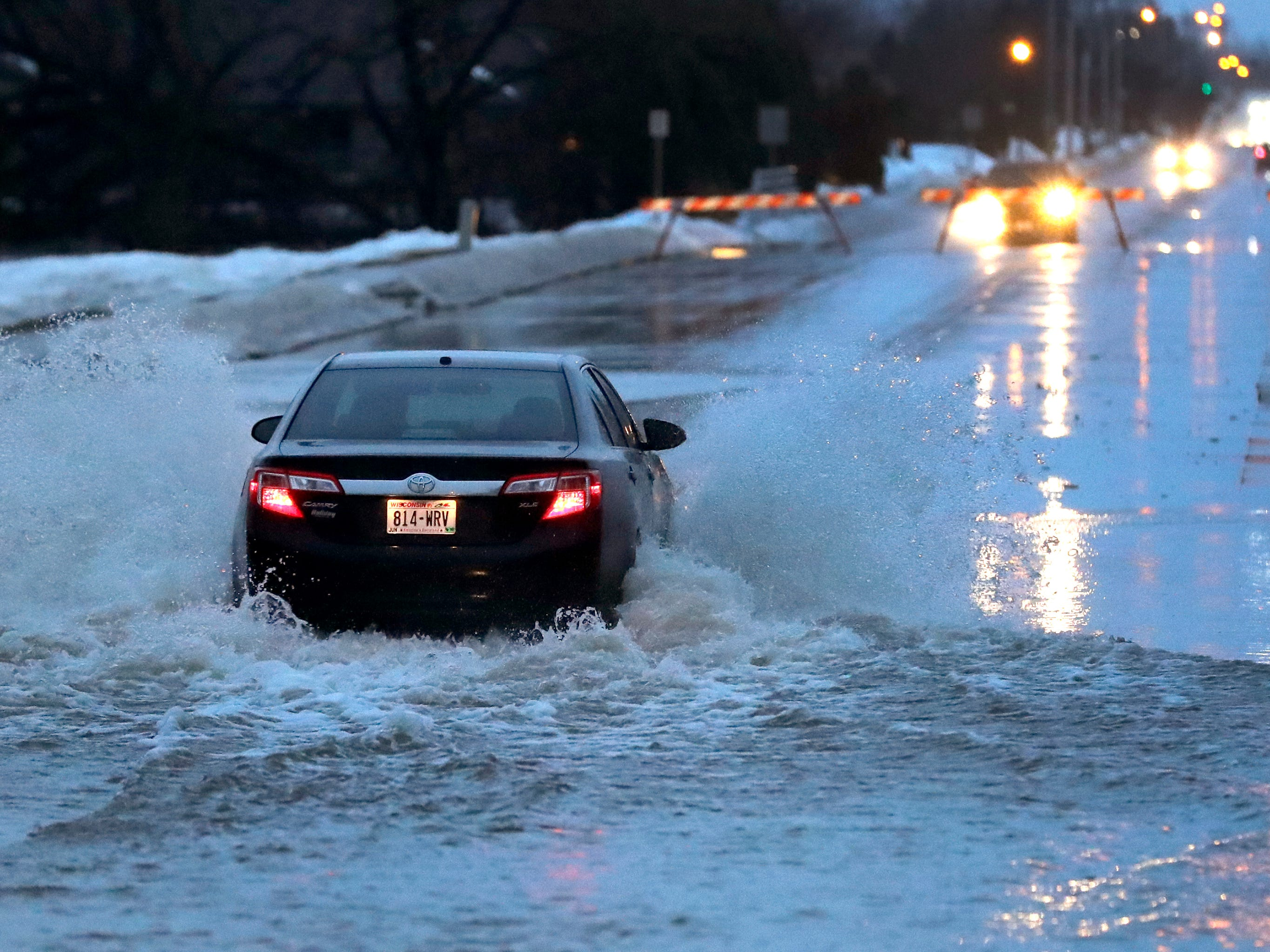 A motorist ignores barricades to travel along a flooded S. Oakwood Road Thursday, March 14, 2019, in Oshkosh, Wis. Dan Powers/USA TODAY NETWORK-Wisconsin