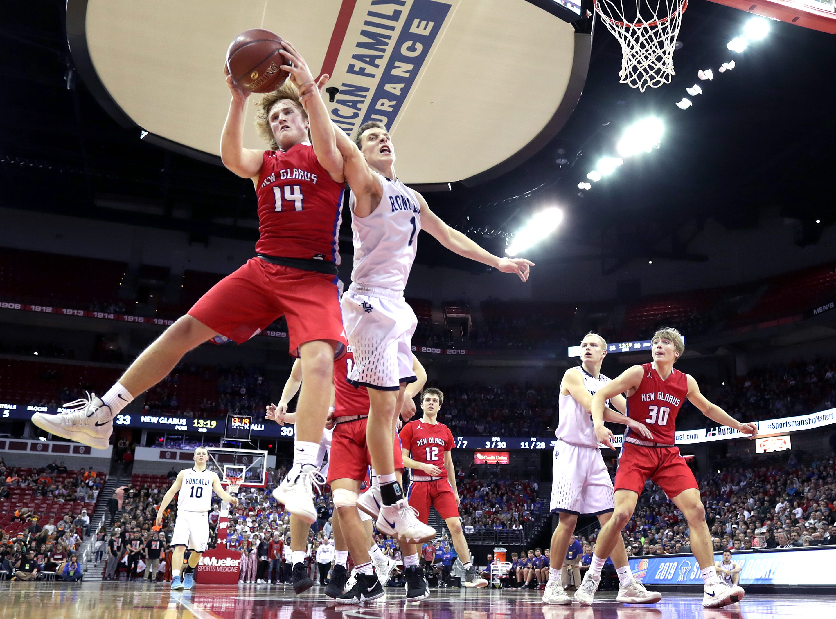 Roncalli High School against New Glarus High School during their WIAA Division 4 boys basketball state semifinal on Thursday, March 14, 2019, at the KohlCenter in Madison, Wis. New Glarus defeated Roncalli 44 to 41.Wm. Glasheen/USA TODAY NETWORK-Wisconsin.