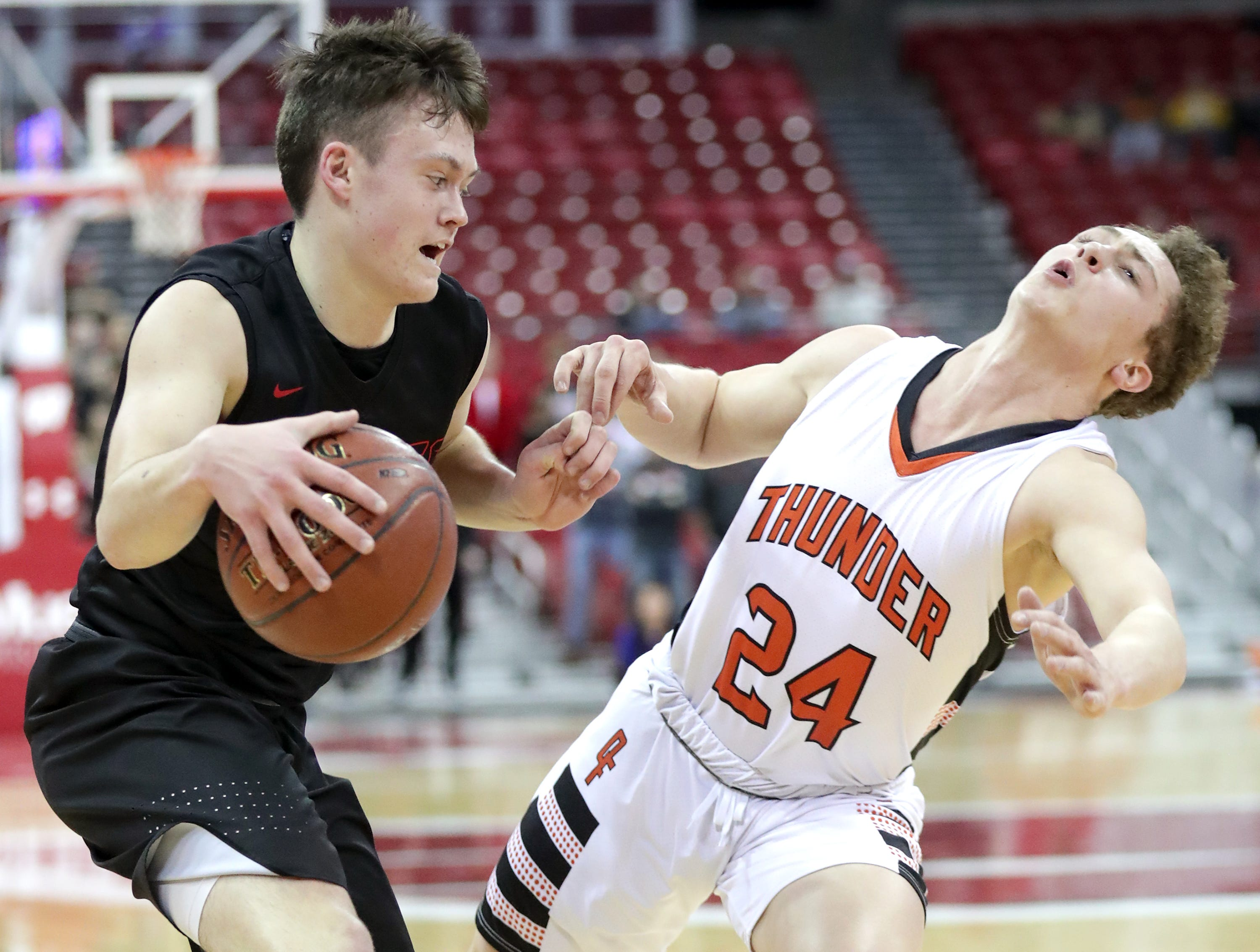 Lourdes Academy's #12 Joshua Bauer against Osseo-Fairchild High School's #24 Caden Boettcher during their WIAA Division 4 boys basketball state semifinal on Thursday, March 14, 2019, at the KohlCenter in Madison, Wis. Wm. Glasheen/USA TODAY NETWORK-Wisconsin.
