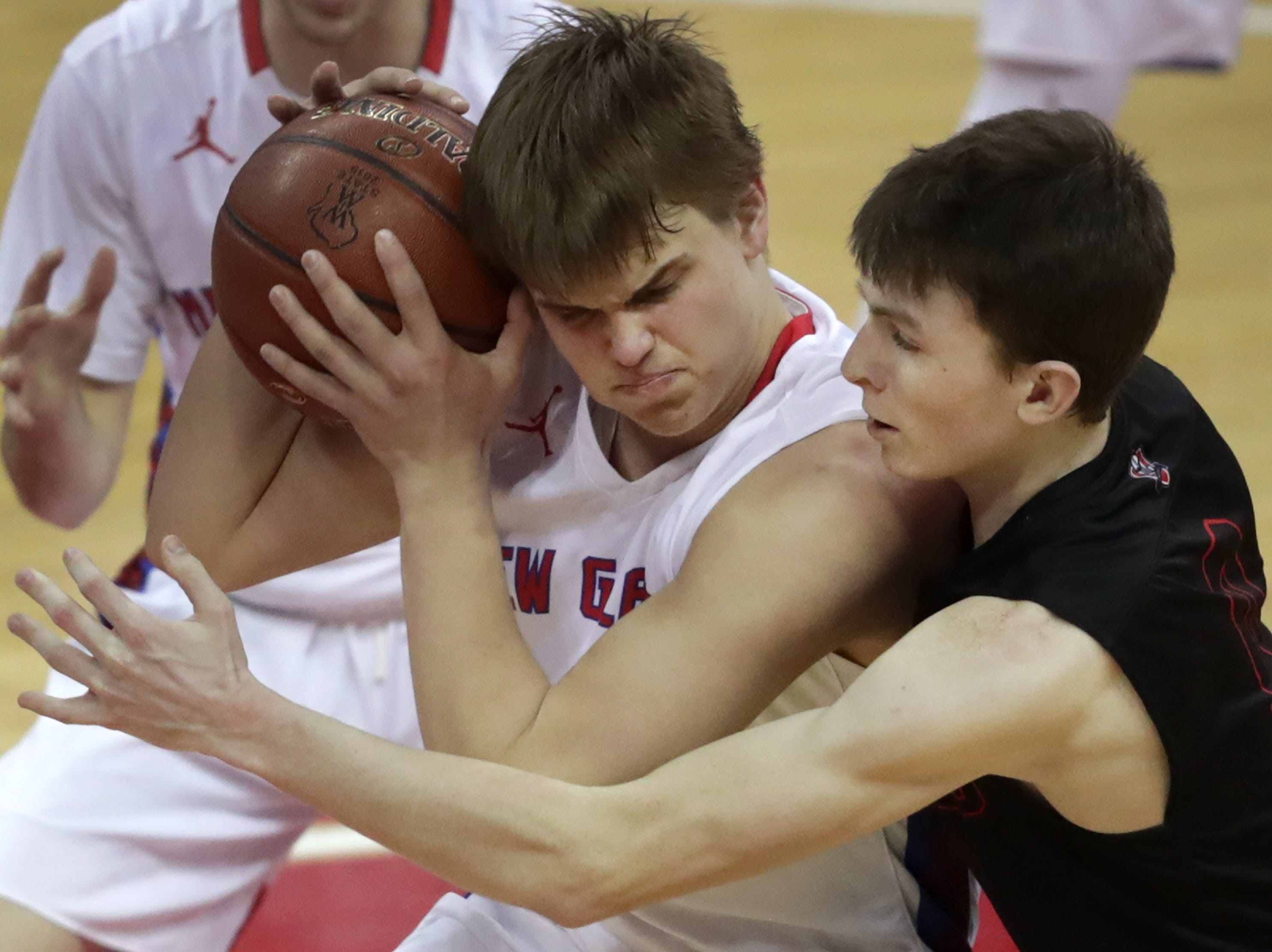 Lourdes Academy's #0 Hayden Jones against New Glarus High School's #1 Mason Martinson during their WIAA Division 4 boys basketball state championship game on Saturday, March 15, 2019, at the Kohl Center in Madison, Wis.New Glasrus defeated Lourdes 67 to 62.Wm. Glasheen/USA TODAY NETWORK-Wisconsin.