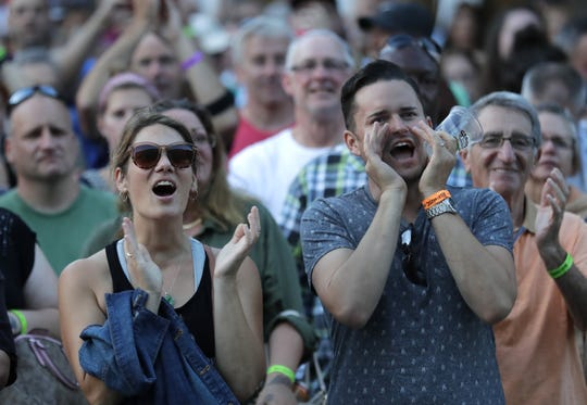 Fans cheer during a performance in Houdini Plaza in the summer of 2018.
