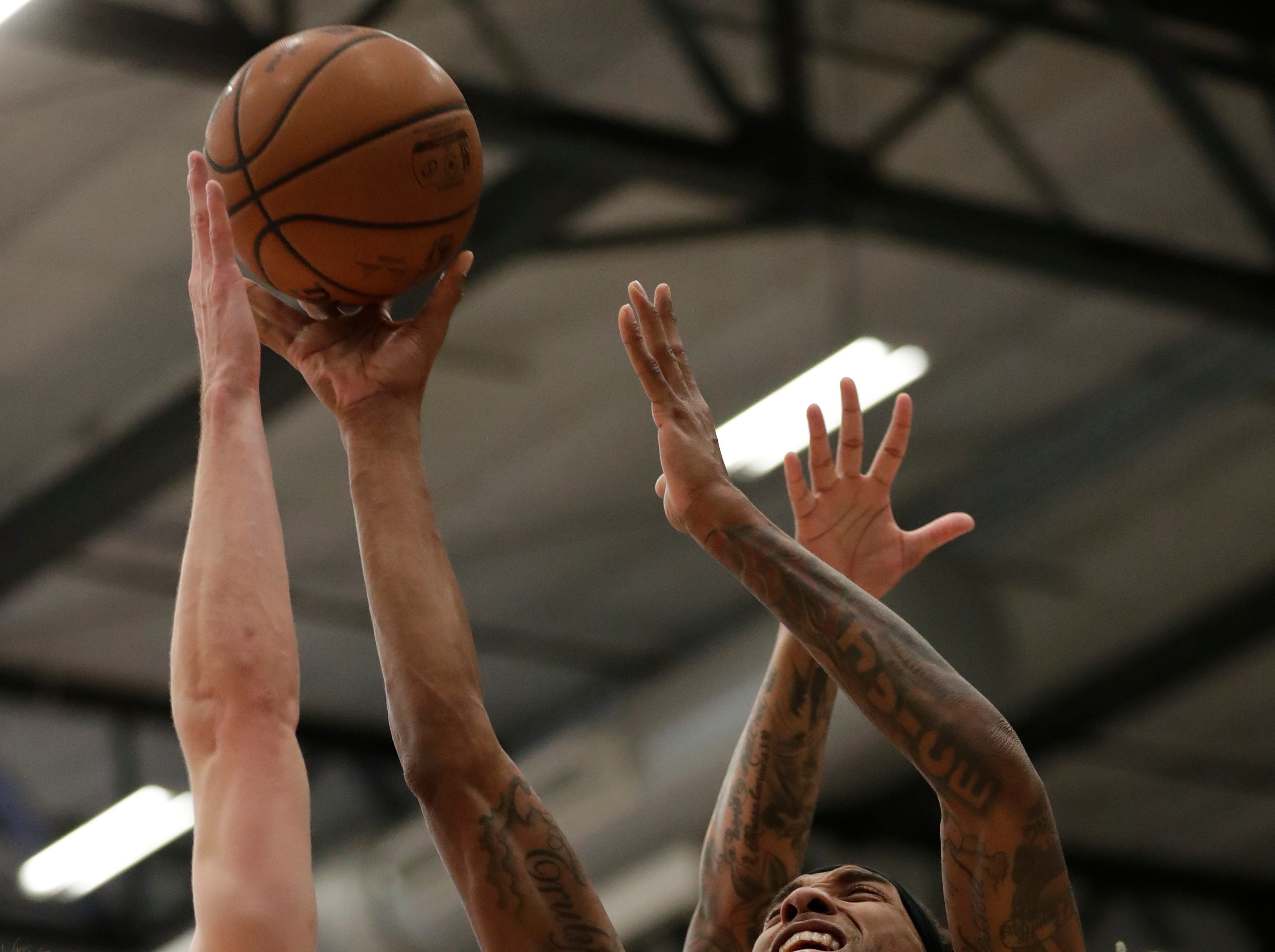 Wisconsin Herd forward Michael Qualls (15) puts up a shot against Lakeland Magic guard John Petrucellli (7) Friday, March 15, 2019, at the Menomonie Nation Arena in Oshkosh, Wis. Dan Powers/USA TODAY NETWORK-Wisconsin