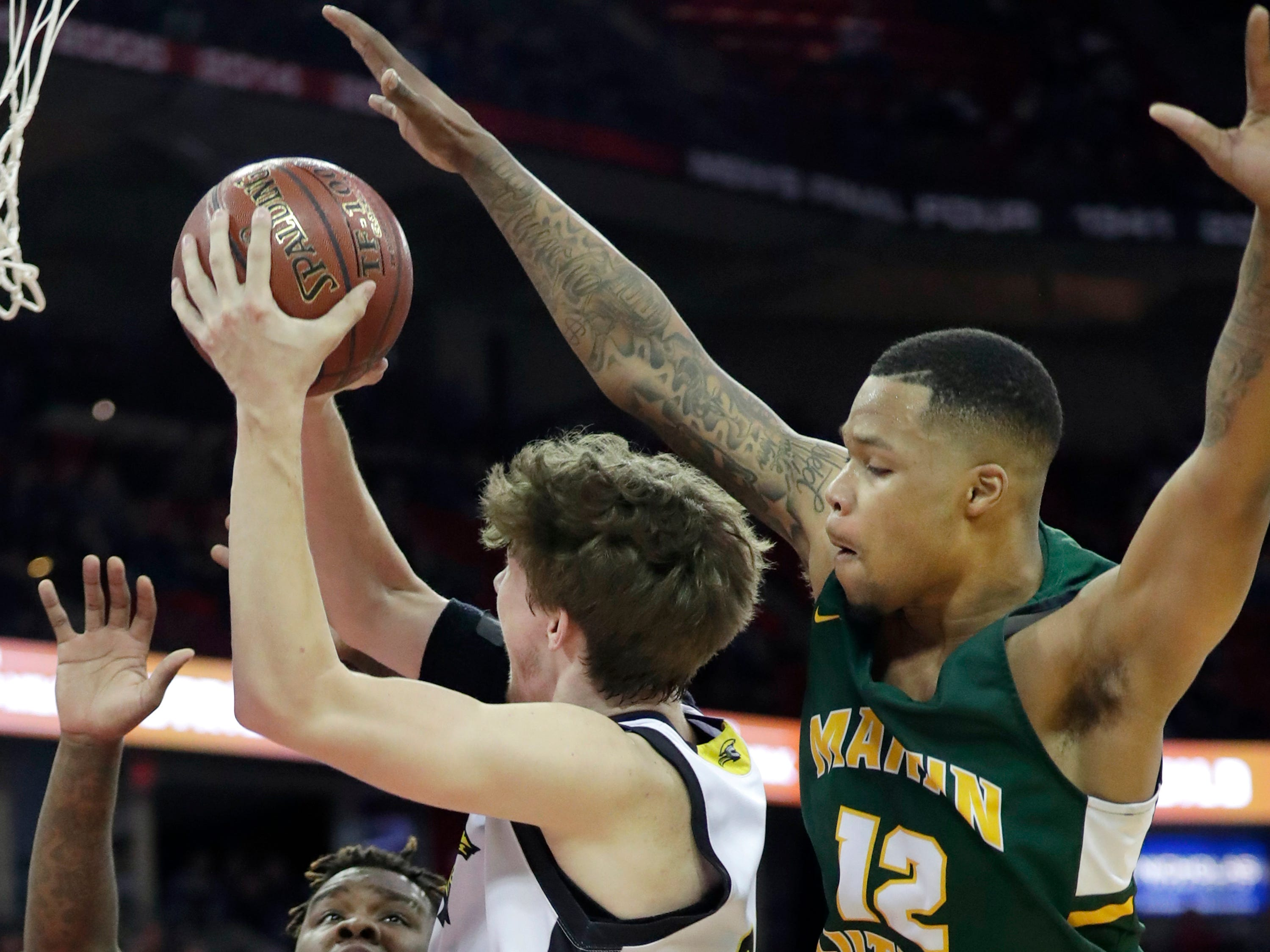 Waupun High School's #23 Reece Homan against Martin Luther High School's #24 Jeramie King and #12 Shaun Harrison during their WIAA Division 3 boys basketball state championship game on Saturday, March 15, 2019, at the Kohl Center in Madison, Wis.Wm. Glasheen/USA TODAY NETWORK-Wisconsin.