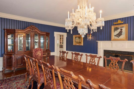 The dining room offers amazing wall paper and hardwood flooring.