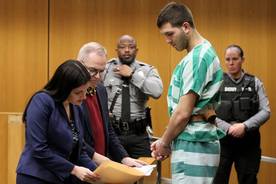 """Assistant Ocean County Prosecutor Hillary Bryce speaks with Anthony Comello, 24, the Staten Island man accused in the killing of reputed Gambino family boss Francesco """"Franky Boy"""" Cali, during his extradition hearing in State Superior Court in Toms River Monday, March 18, 2019.  Also shown is Comello's attorney Brian J. Neary."""