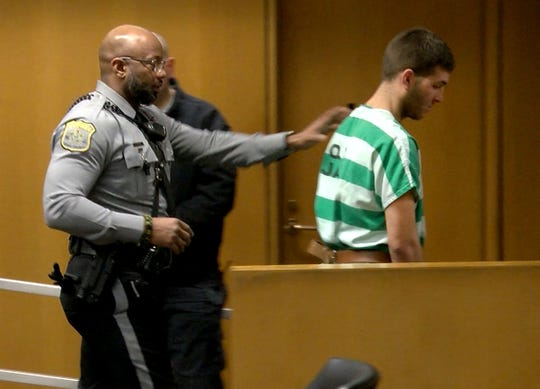 """Anthony Comello, 24, the Staten Island man accused in the killing of reputed Gambino family boss Francesco """"Franky Boy"""" Cali, is escorted from State Superior Court in Toms River Monday, March 18, 2019, after his extradition hearing there."""