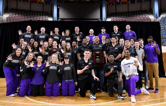 The men and women's Abilene Christian University basketball teams pose for a group photo Monday at Moody Coliseum.