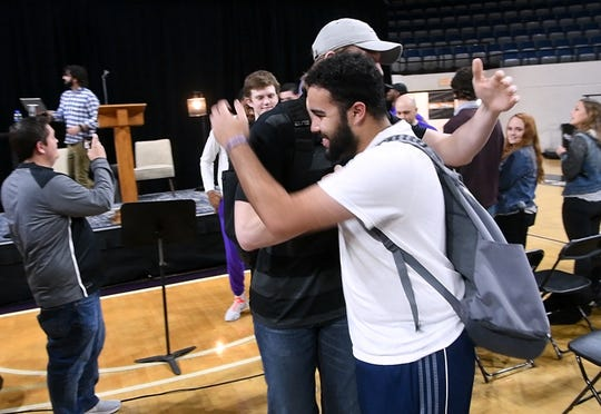 ACU Men's Basketball student manager Chris Garcia greets players on the team as they enter Moody Coliseum for Chapel Monday March 18, 2019. Both men's and women's basketball teams were honored for earning bids to play in the upcoming NCAA tournaments.