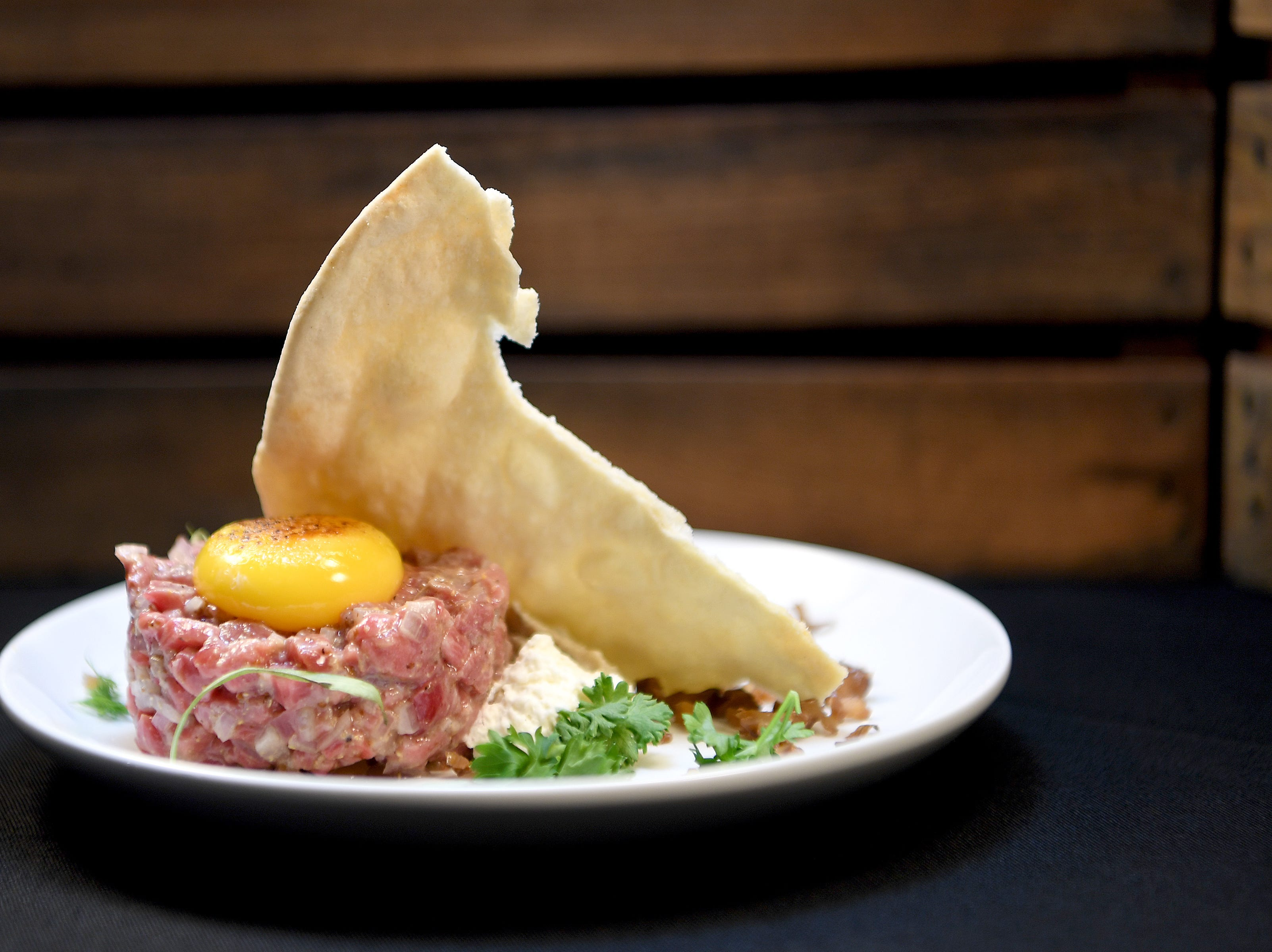 The Bavette steak tartare at Daphne at Twisted Laurel features smoked eggplant and marrow espuma, sunchoke tahini, lavash, pickled walnut salsa and topped with a blisted yolk.