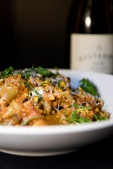 The tagliatelle bolognese at Daphne at Twisted Laurel is braised hen, black lime crema, parmesan and pistachio.