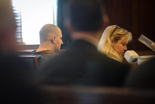 James Michael Norton, 33, sits in court with his attorney, LeAnn Melton.