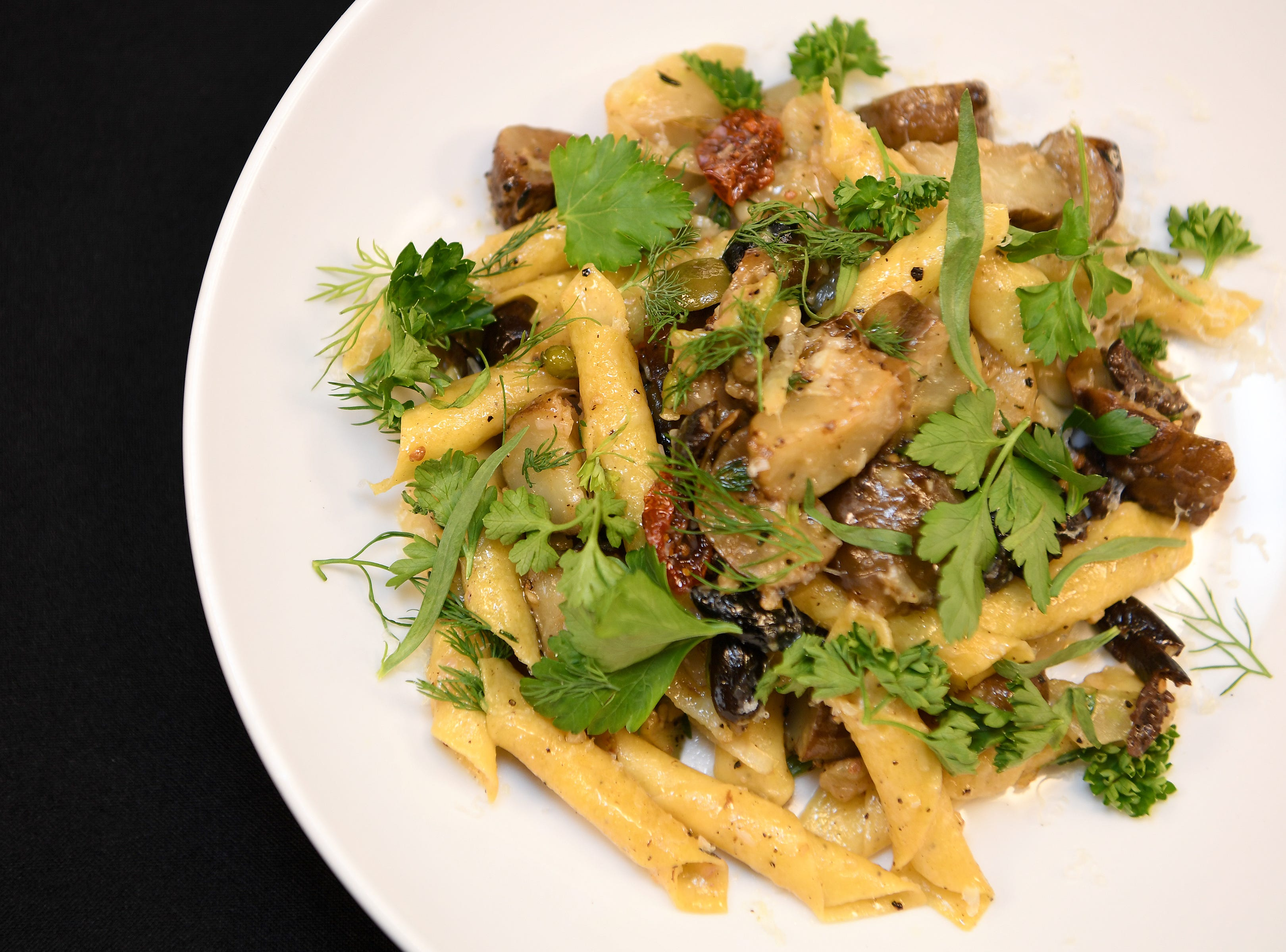 The garganelli pasta at Daphne at Twisted Laurel featured toasted fennel, tomato, caper, cracked olive, guanciale, sunchoke, pecorino and herbs.