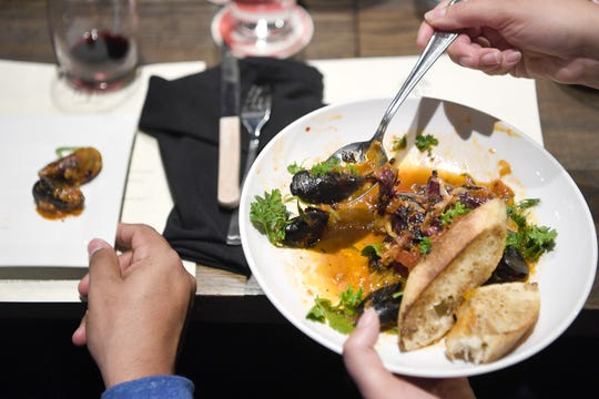 The PEI mussels at Daphne at Twisted Laurel feature nduja, smoky tomato, chicories and are served with grilled bread.