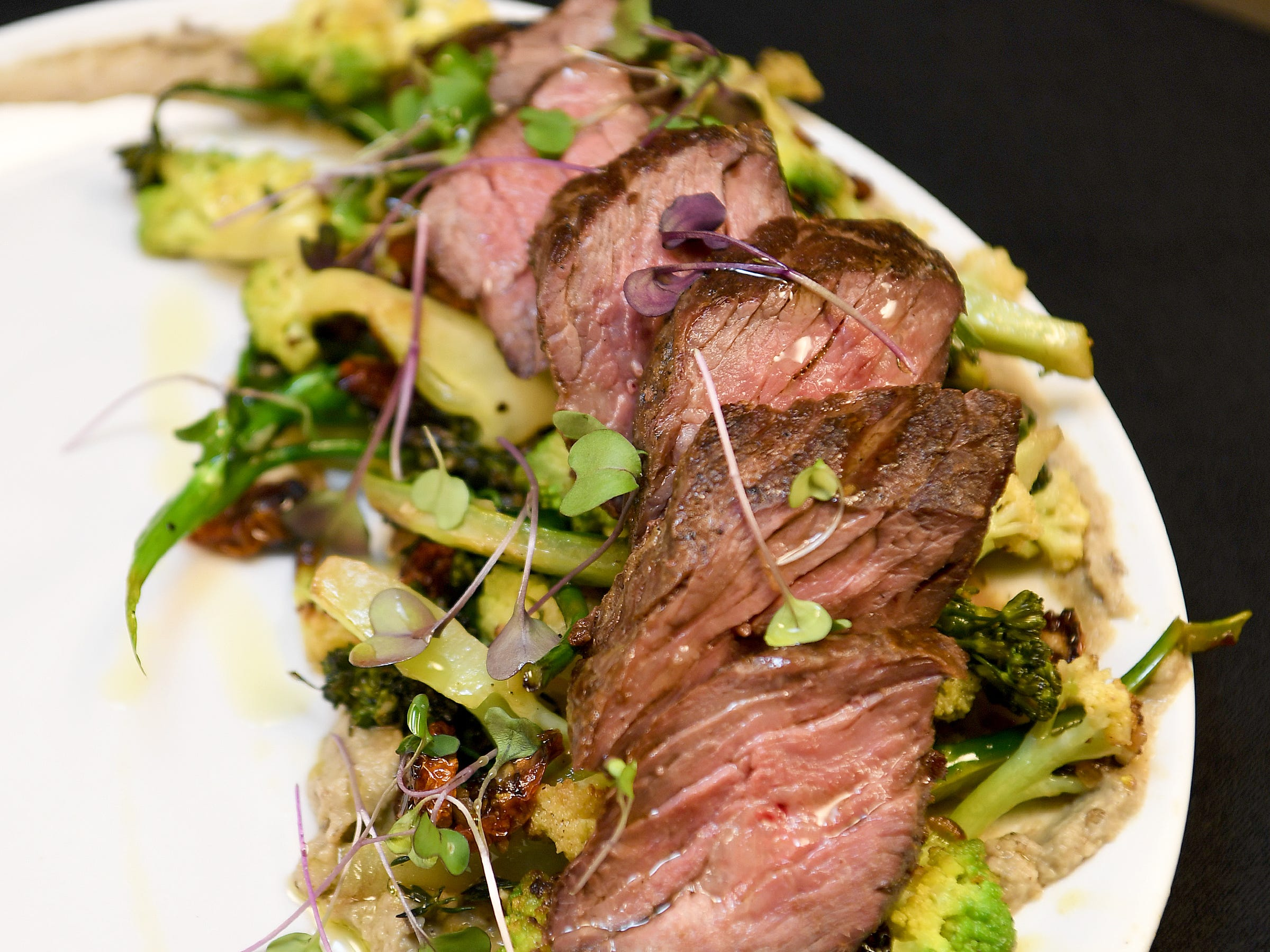 The Bavette steak at Daphne at Twisted Laurel is served with broccolini, smoked baba, tomato, romanesco, chermoula and caulini.