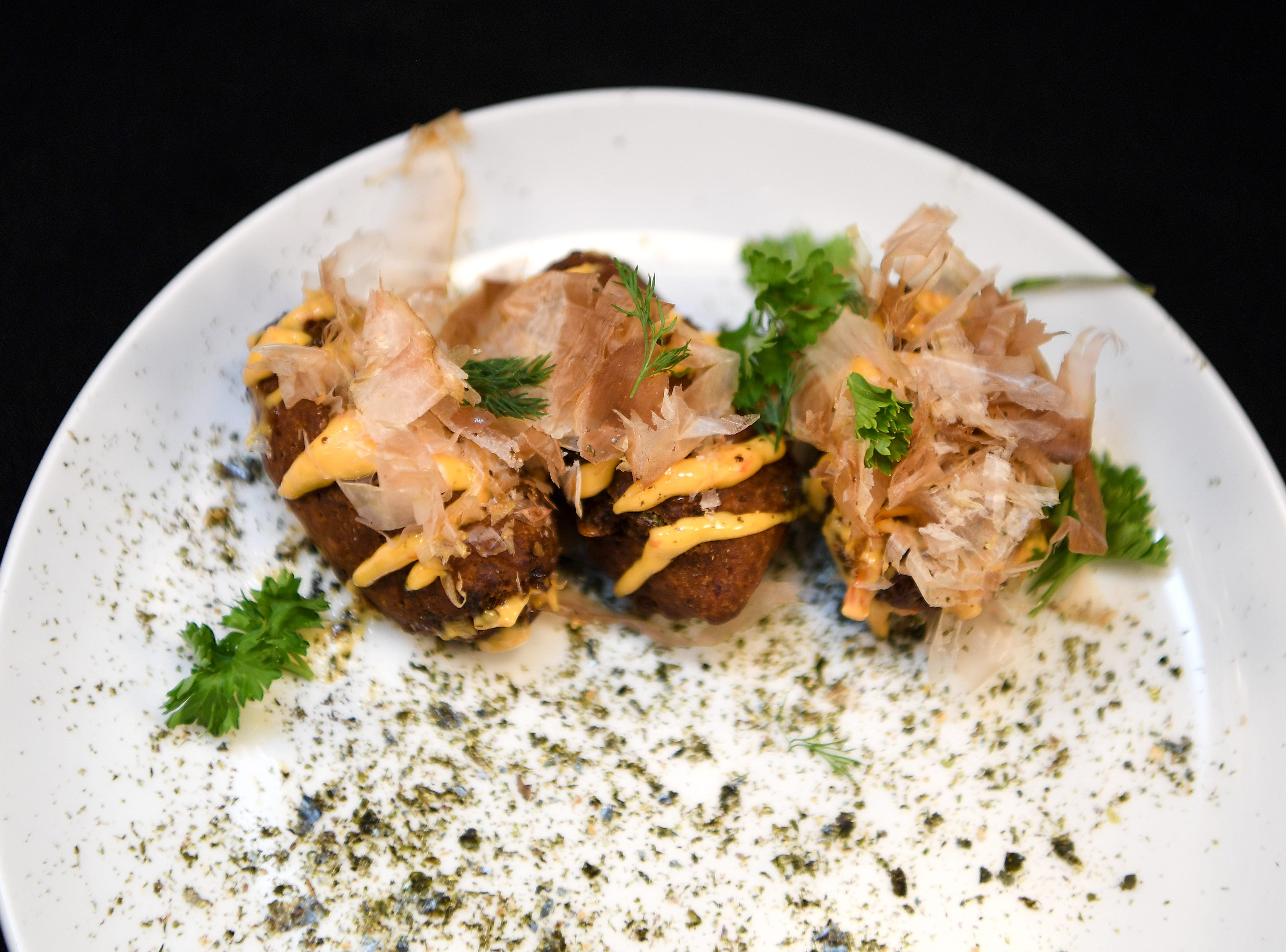 The smoked trout fritters at Daphne at Twisted Laurel are topped with a spicy remoulade, black lime and toasted nori.
