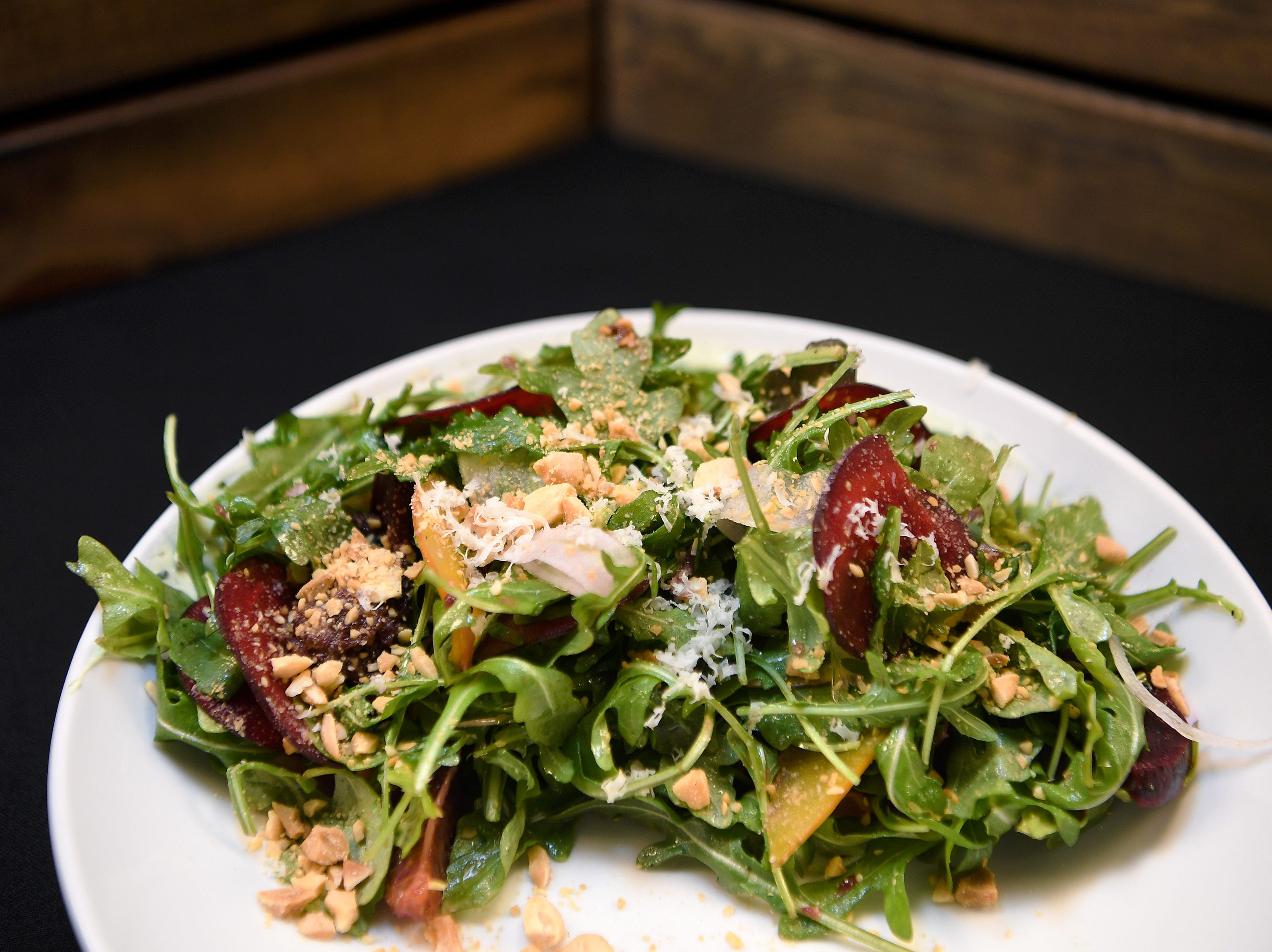 The shaved and roasted beets at Daphne at Twisted Laurel are a salad of arugula, horseradish, marcona, blood orange, mostarda, fennel, whipped chevre and shaved sunchokes.