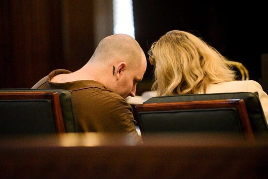 James Michael Norton, 33, speaks with his attorney, LeAnn Melton, on March 18.