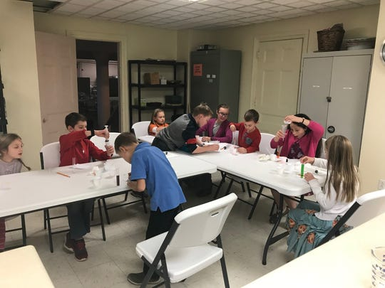 Students in the Binghamton chapter of Catholic Schoolhouse perform experiments during a chemistry lab. Catholic Schoolhouse is a homeschooling program for Catholic students.
