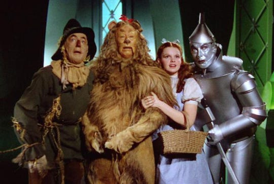 From left, the Scarecrow (Ray Bolger), the Cowardly Lion (Bert Lahr), Dorothy (Judy Garland) and the Tin Man (Jack Haley) are off to the see the Wizard.