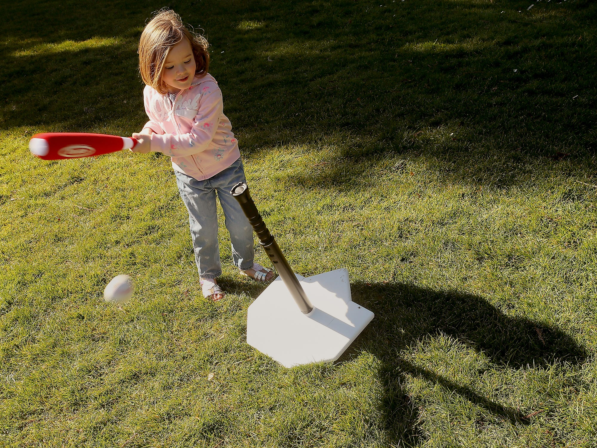 Natalie Voorhies, 3, bats with her T-Ball set as she and her mother Lisa take advantage of the nice weather at Evergreen Rotary Park in Bremerton on Monday, March 18, 2019.