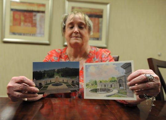 Patsy Phillips, resident of the N.C. State Home for Veterans in Black Mountain, holds up a rendering, right, depicting how the proposed Women in Military Service for America Memorial would look. A postcard, left, shows the memorial, which Phillips visited as part of a Second Wind Dreams program, as it looks today.