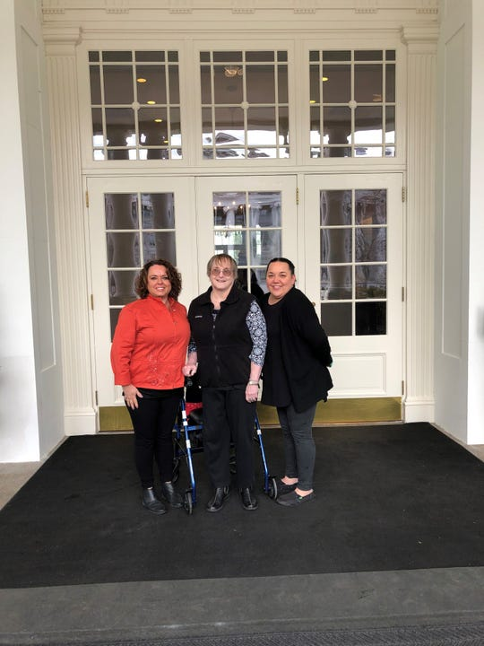 Patsy Phillips, center, N.C. State Veterans Home admissions director Tonia Holderman, left, and nurse Brandy Sigman stand outside of the White House on Feb. 26.