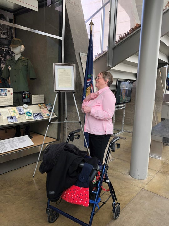 Air Force Veteran Patsy Phillips, who was stationed in Okinawa, Japan during the Vietnam War, has an emotional moment in front of the display from that era at the Women in Military Service for America Memorial in Arlington, Virginia.