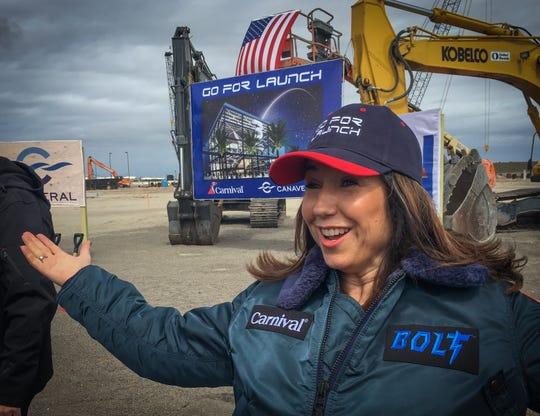 """Carnival Cruise Line President Christine Duffy, wearing a """"Go for Launch"""" cap and a jacket promoting Carnival's new roller coaster at sea, details the features of the Carnival Mardi Gras, which will be based at Port Canaveral beginning in October 2020."""