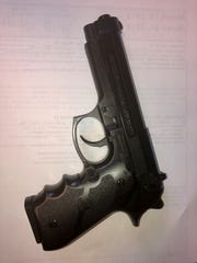 Replica 9mm  police seized Monday from man suspected of threatening officers.
