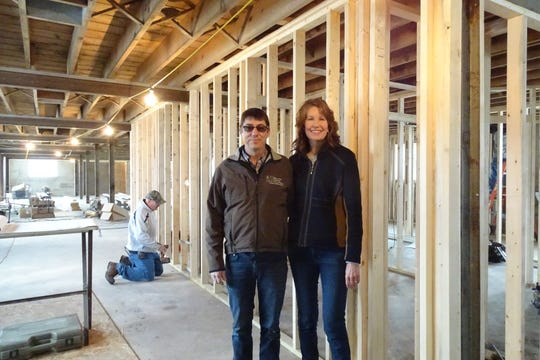 Kent and Laura Stuckey stand inside the building that will house The Stalls at Pickwick as construction continues around them.